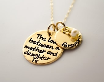 Hand Stamped Necklace GOLD Necklace with quote The love Between a Mother and daughter is forever