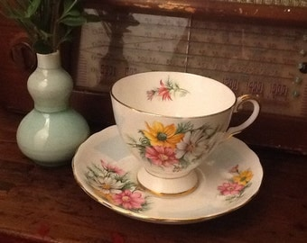 Vintage Tuscan Teacup and Saucer Made in England Birthday Flowers Blue Pink Yellow Gold Cosmos October.