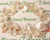 1 strand approx. 65 pcs 22x21mm to 10x9mm Genuine Mother of Pearl Shell top drilled Graduated Fan shape.