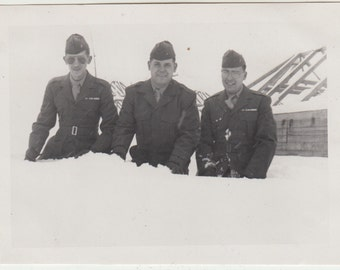 1954 Vintage/Antique beautiful photo of three men in uniforms sitting on the snow