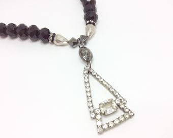 Vintage rhinestone geometric pendant necklace.