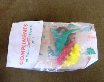 Sinclair toy dinosaurs in original header bag vintage toys