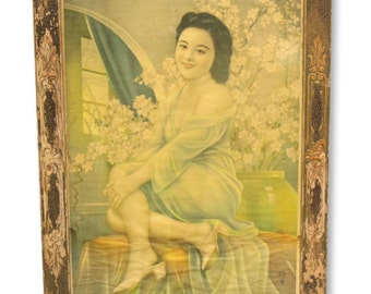 Asian portrait in ornate wood frame