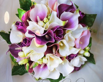 Bride, bridesmaid bouquet - real touch flowers.  Calla lilies, tulips and freesias in shades of purple, pink and white.