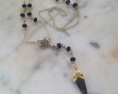 Gold and black dagger rosary