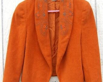 Orange jacket by Leslie Fay.