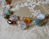Vintage wrapped agate and stone necklace.  24 inches.  With dangle earrings.  Gold.  Banded agate.