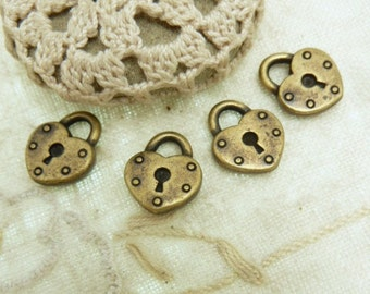 4 antique bronze metal heart lock  charms size is 14 MM x 16 MM