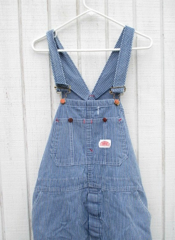 The hickory stripe is an overalls classic. Ordered these based on size of my indigo bibs and are very similarly sized. Washed cold water and dried in med heat and experienced minimal shrinkage.
