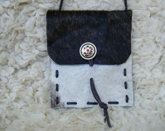 Purse, hair on cowhide, with beautiful concho. 6X7 inches