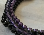 Black and purple stretch bracelet. beaded stretch bracelet