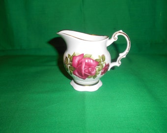 One (1), 4 oz. Bone China Creamer, from Elizabethan China, in a Rose Design.