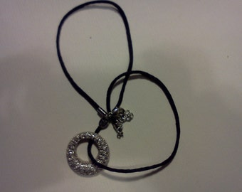 """One (1), Kiam Family,  Crystal Pave, Circle Pendant, on a 18"""" Black Cord Necklace."""