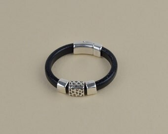 Black leather bracelet with silver plated slider-beads and magnetic clasp.