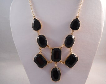Bib Necklace with Gold Tone and Black Crystal Pendant Beads on a Gold Tone Chain
