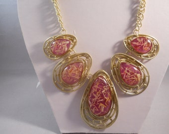 Gold Bib Necklace made with gold tone Pendants and Pink and Gold crystal Beads
