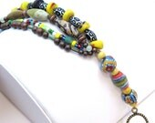 Recycled glass, vintage japanese beads, colorful, funky, eclectic mix of beads, bracelet strung on cord. some handknotting