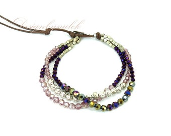 Purple crystal,silver plated beads on wax cotton bracelet.