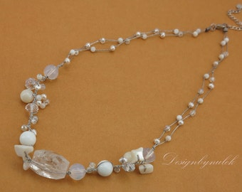 White freshwater pearl quartz on silk necklace.