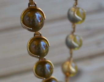 Superb antique machine age art deco gold plate statement choker necklace with golden amber color lucite balls / pools of light