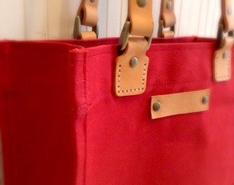 Waxed canvas tote bag with leather handles