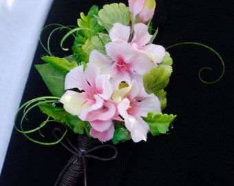 Boutonniere, boutineer, lapel flower pin,  pink geranium blossoms, fancy greens