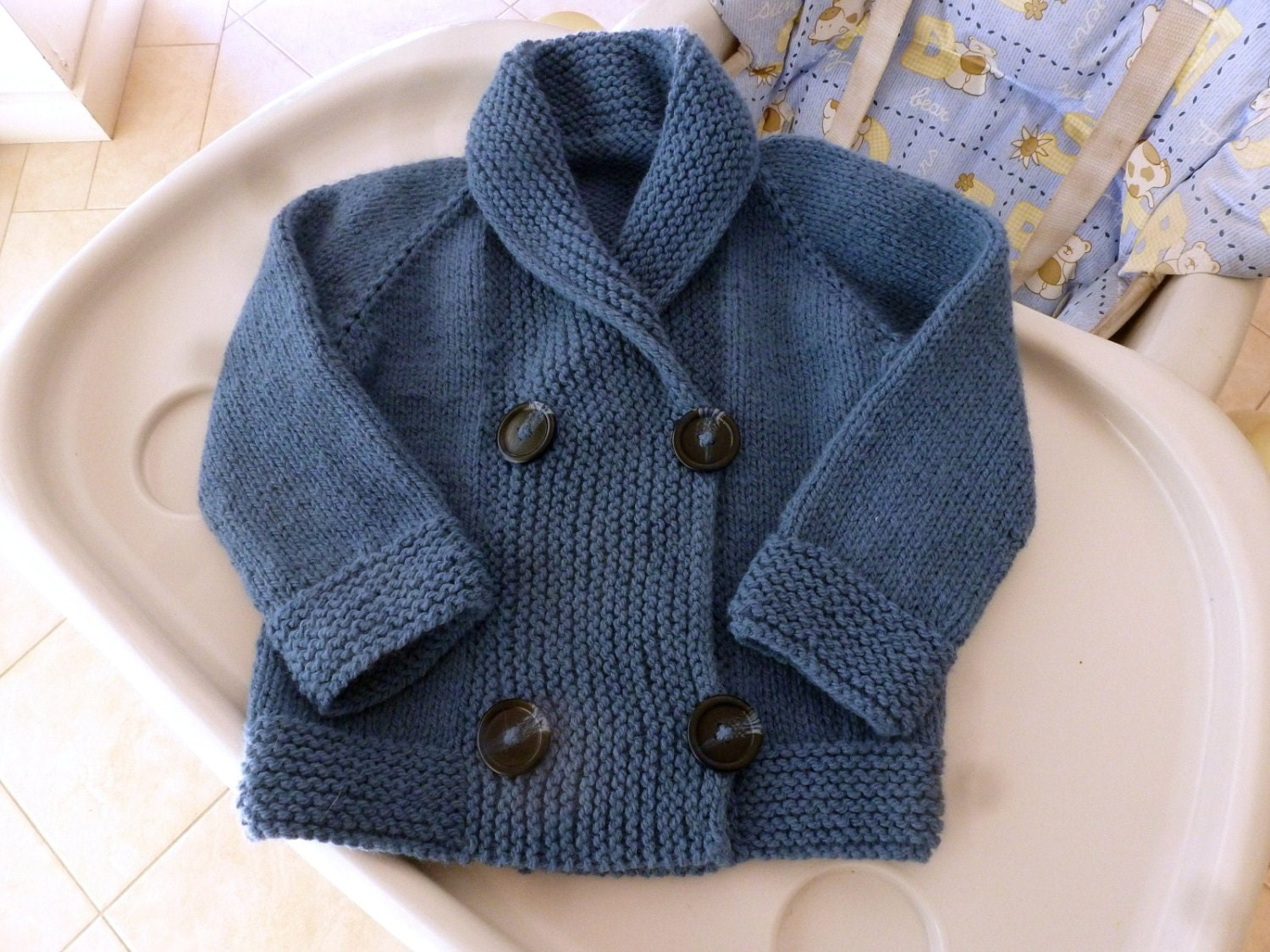Hand knitted double breasted baby jacket shawl by SnuggleBubs