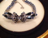 Blue bow rhinestone bracelet.