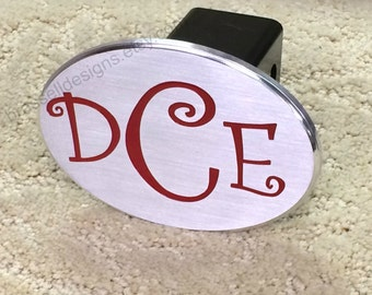 Curlz monogram hitch cover