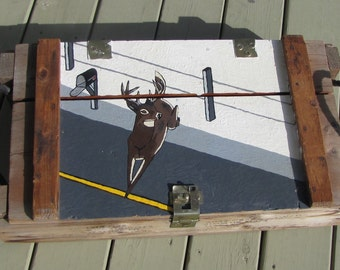 ammo box with deer painting on it