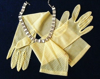 Evening gloves, vintage, elbow length, sheer, in a lovely shade of lemon yellow,  label -nylon, size 7, Made in England, c1950's 60's.