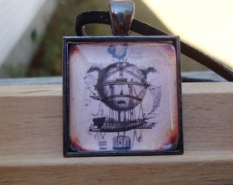 "Flying Machine, Gunmetal 1"" Square Glass Pendant"