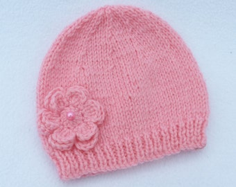 Baby girl hand knitted salmon pink beanie hat to fit 0-3 months