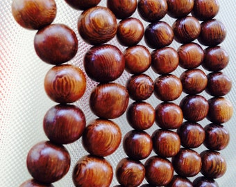 """Robles wood beads 10mm , 16"""" strand, imported from the Philippines"""