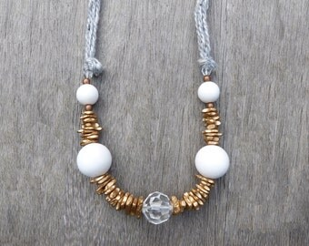 Unique and Geometric necklace, grey wool, golden seeds, white and copper acrylique beads, glass beads, adjustable long or short by knot