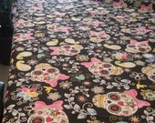 2.7 yards X 1.25 yards of Mexican  with colorful designs like calaveras,  day of the death