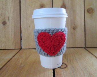 Grey crochet coffee cozy with red heart