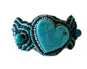 Bead embroidery cuff bracelet with a turquoise heart. Seed bead jewelry in grey and turquoise.