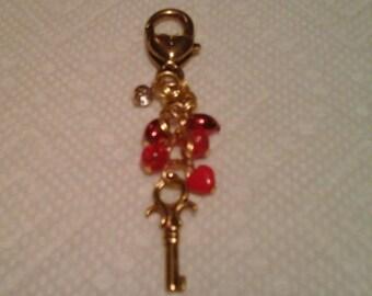 Gold tone heart charm phone, purse, key chain or zipper pull