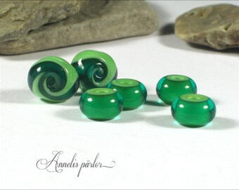 Items similar to pale green handmade lampwork beads for Glass discs for crafts