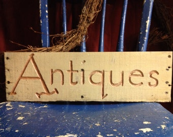 Antiques .  Etched sign on reclaimed wood