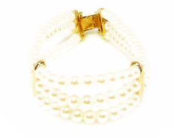 Three Strand Faux Pearl and Gold Tone Napier Bracelet
