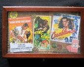 Remotes caddy.  Vintage Gone with the Wind, King Kong, Casablanca imagery.  Jewelry box, tea caddy or for family room or man cave.