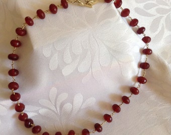 Gorgeous faceted red jade wire wrapped (for security) in gold plate. Unusual vermeil leaf toggle clasp.
