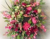 Spring Floral Wreath in shades of Pink and Green with a triple bow