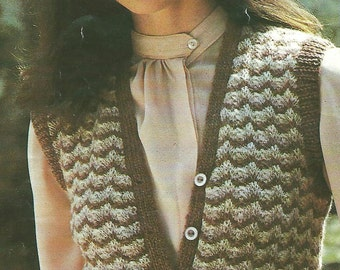 This is traditional style of handknitted waistcoat made in a lacey pattern using naturally coloured wool