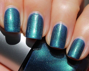 Kiss the Girl Franken Nail Polish - Dark blue slightly teal with green highlights