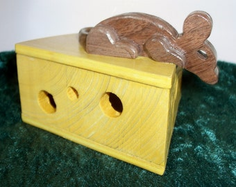 Wood box disguised as a wedge of cheese with a wooden mouse perched on top