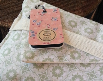 Pale green, circle and flower print cotton clutch bag