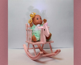 Vintage baby doll with rocking chair/horse, carrycot, clothes